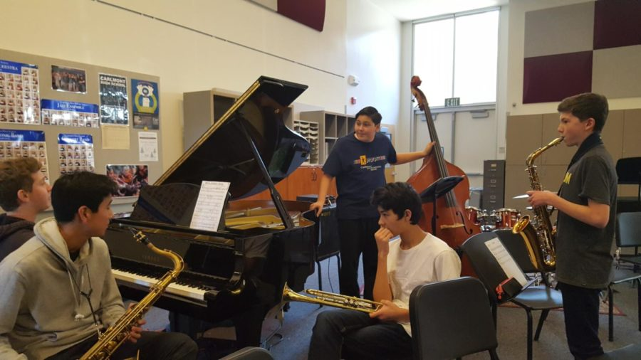 Jazz+club+discussing+a+song+they+just+began+learning+that+day.+