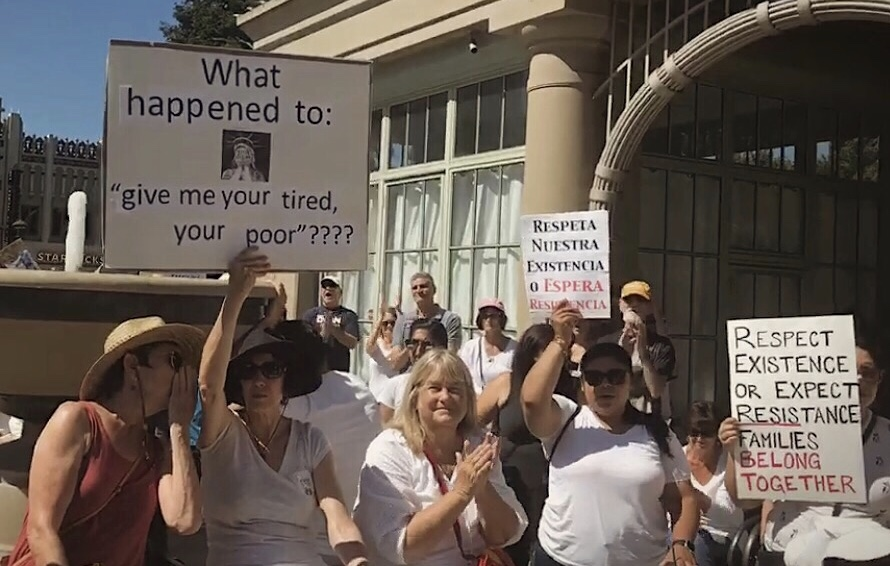 Crowds wearing white unite to protest the family separation of asylum seekers at the Redwood City Town Hall on June 30, 2018.