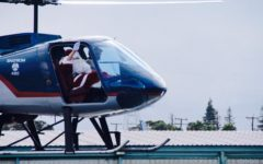 Santa leaves his sleigh and arrives by helicopter