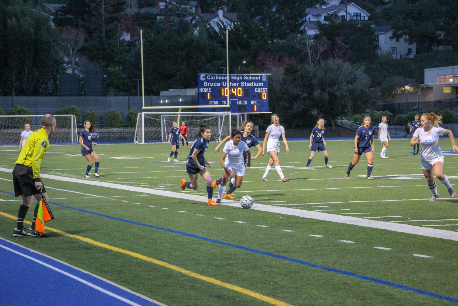 Kaylee Leong, a senior, takes a defender down the wing during the first half.