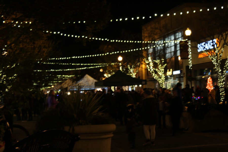 The lights strung across the street illuminate the night.