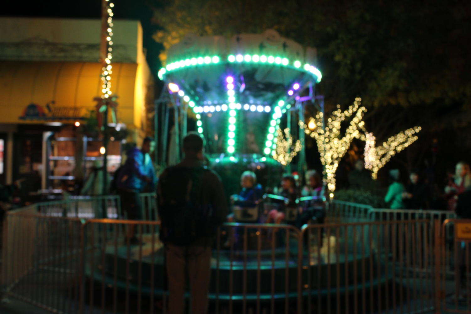 Kids+swing+around+on+one+of+the+rides+that+the+festival+offered.