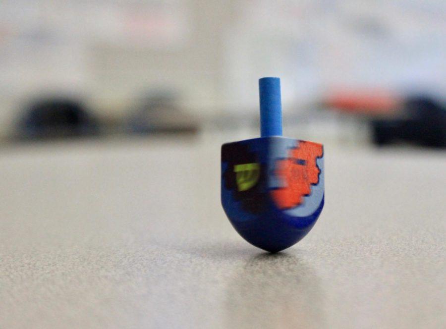 A dreidel spins on a desk in C14.