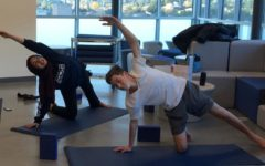 Iman Sarsour and another club member work on flexibility and strength in the weekly yoga lesson.