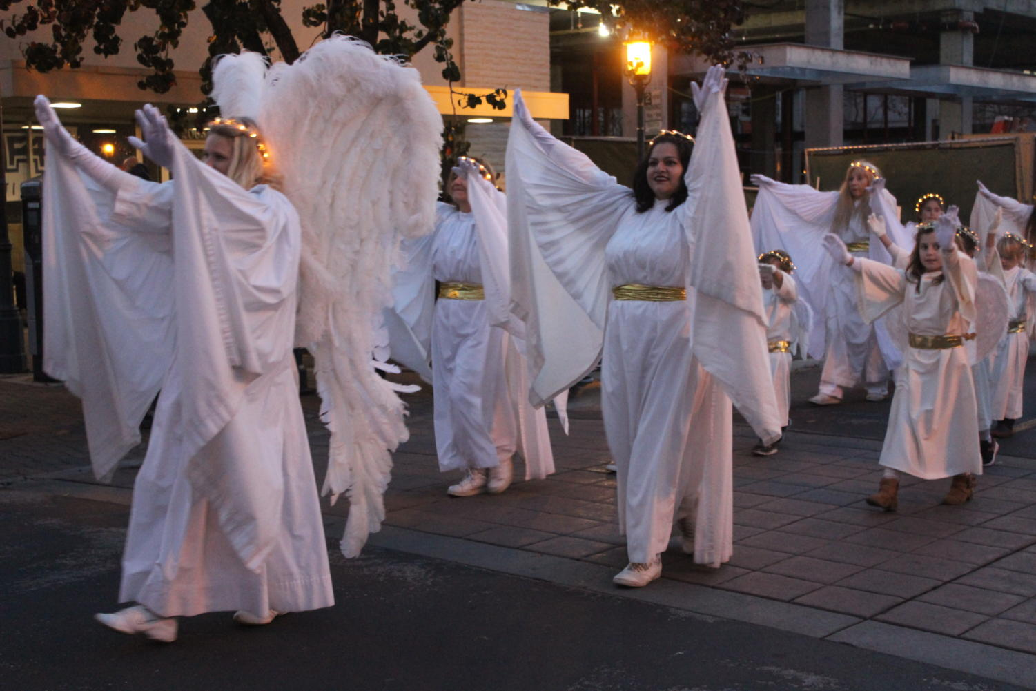Angels+walk+through+the+parade+from+Bethlehem+A.D.%2C+a+group+that+recreates+and+performs+scenes+from+the+Bible.