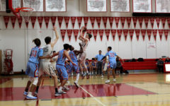 Boys varsity basketball knocks Hillsdale Knights off their steeds