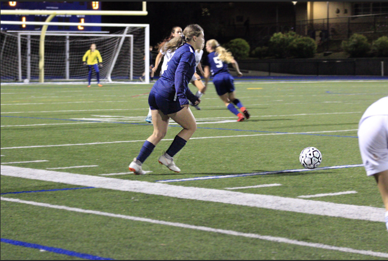 Constance+Herrero%2C+a+junior%2C+gets+ready+to+cross+the+ball+to+her+teammate.