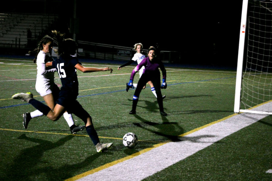 Jenna Reinhardt, a freshman at Carlmont, whips in a cross during the first half.