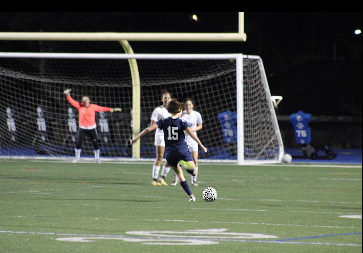 Jenna Reinhardt, a freshman, takes a free kick.