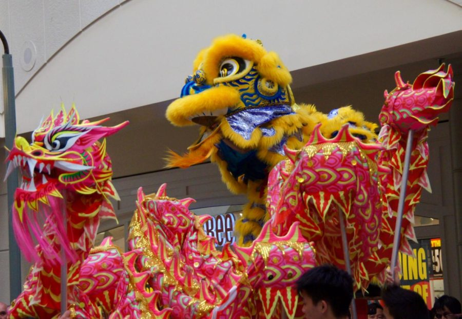 Teenagers from LionDanceME perform the finale of the lion and dragon dance.