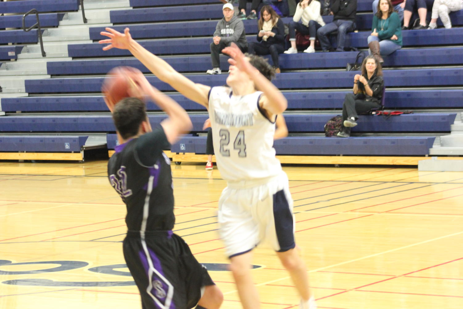 Sophmore Miles Ozorio blocks a shot from a Sequia player.