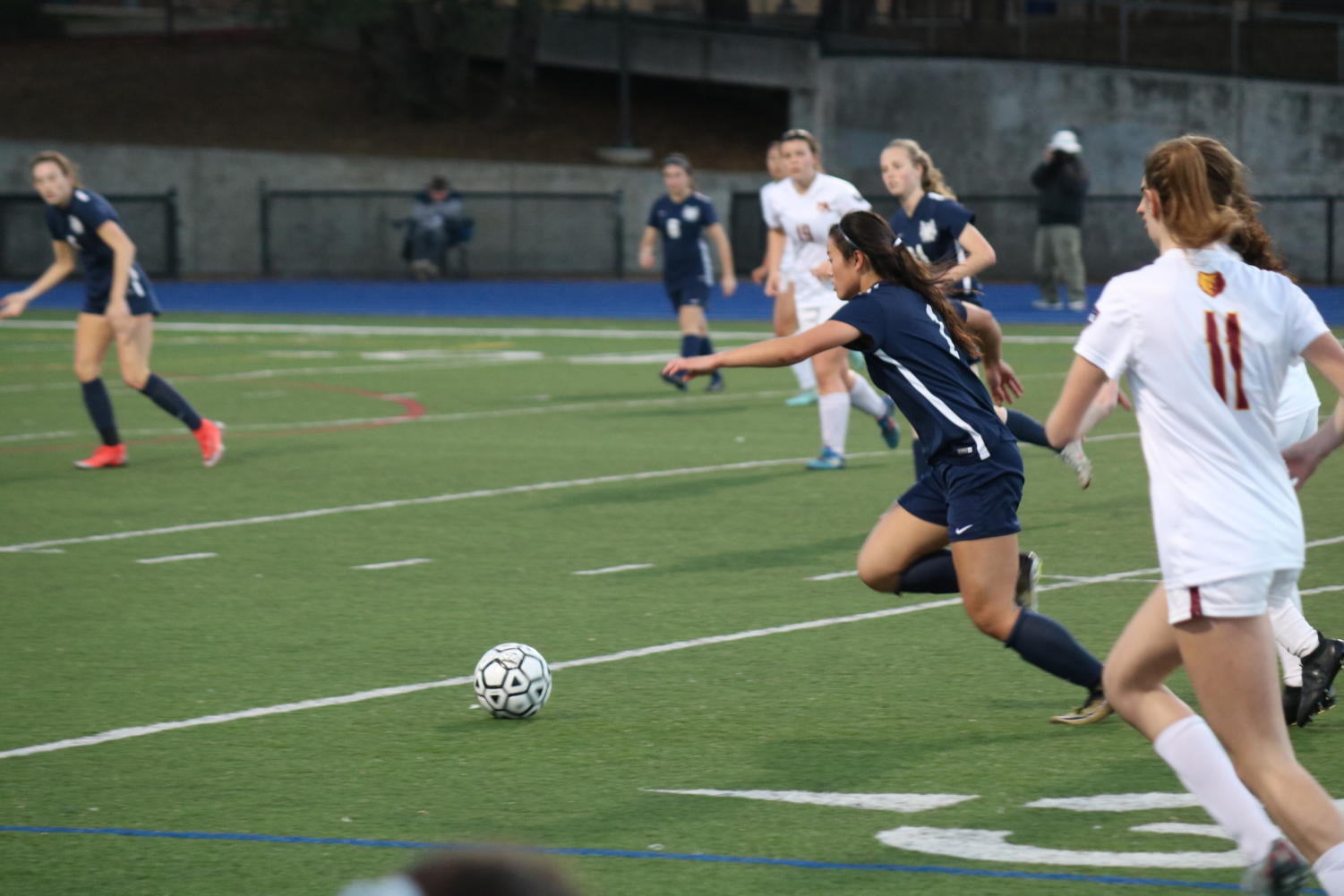 Ali Uozumi, a sophmore, charges towards the goal with the ball.