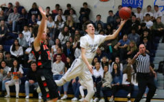 Boys varsity basketball domesticates Woodside Wildcats