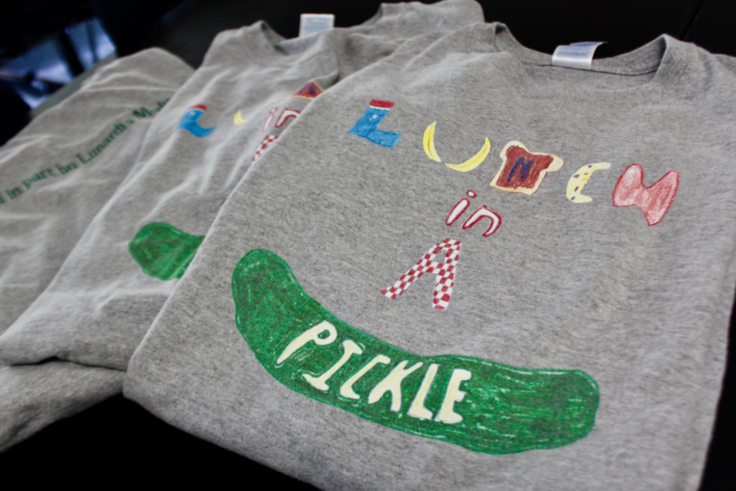 Specially designed t-shirts serve as uniforms for students who deliver sandwiches for Lunch in a Pickle Club.