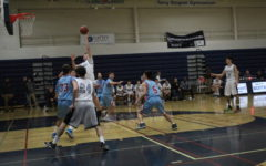 Will Hesselgren, a sophomore, attempts to score more points for Carlmont.