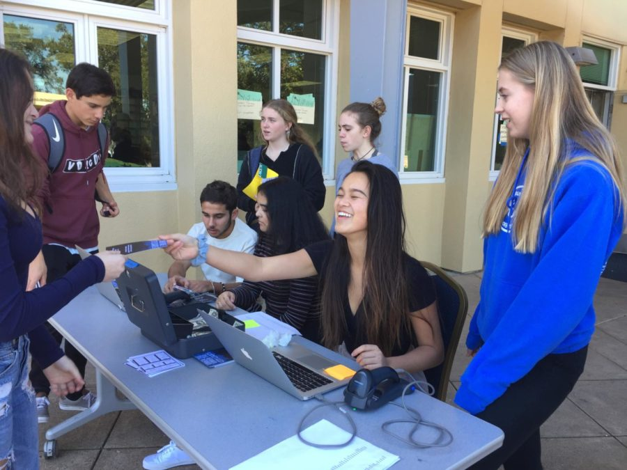 ASB sells tickets to the Winter Formal in the quad.