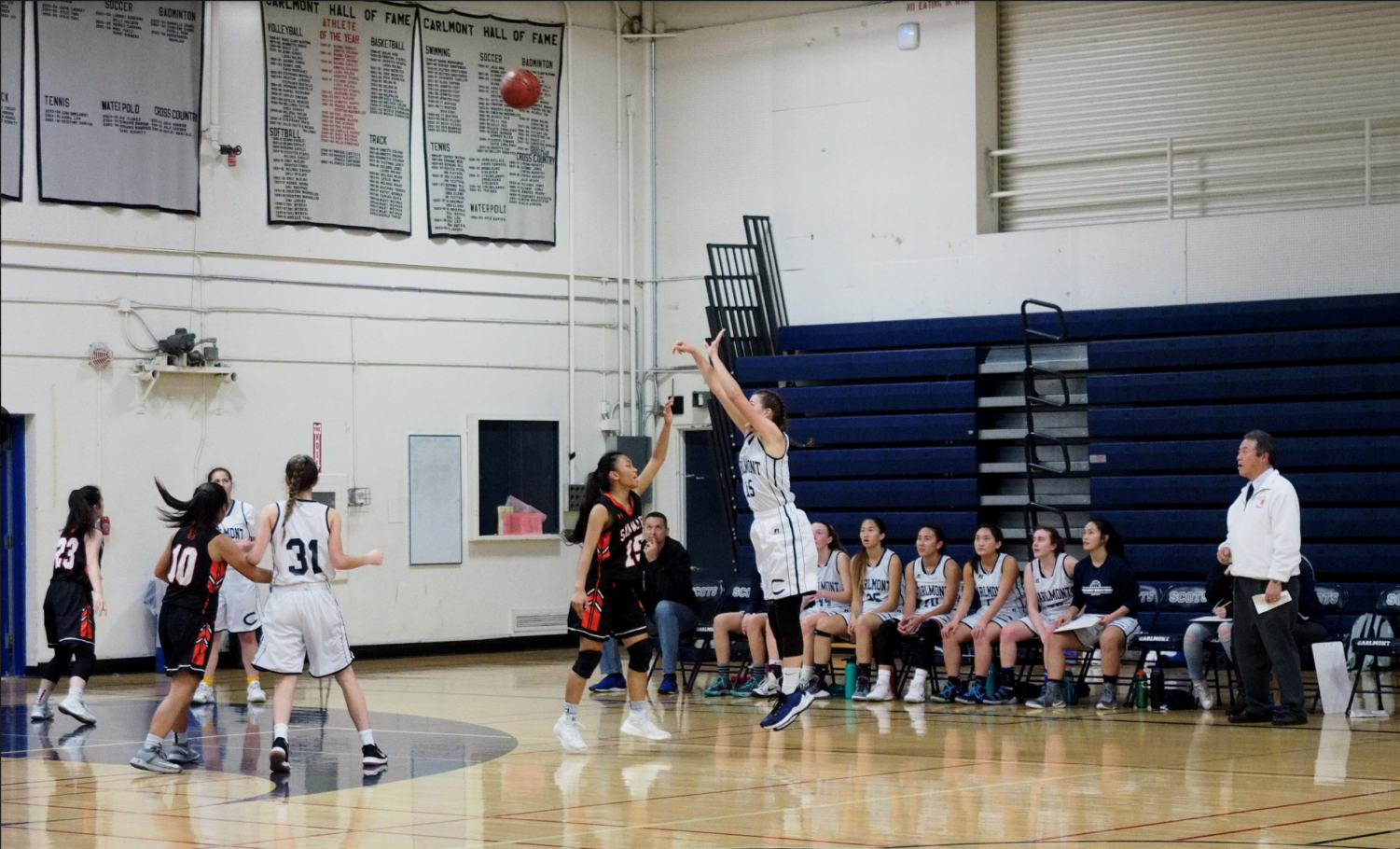 Ashley Trierweiler, a senior, goes for a 3-point shot.