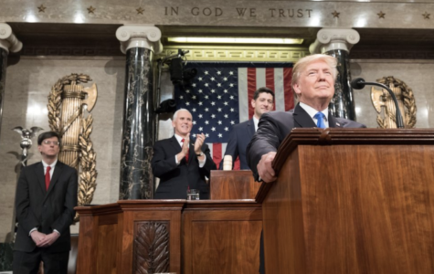 President Donald Trump stands proudly after delivering the State of the Union address in 2018.