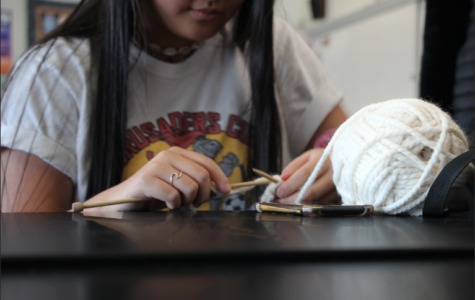 Mairwyn Forster, a sophomore, works on knitting a new product.