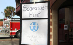 The posted scavenger hunt sign directs participants to the front desk.