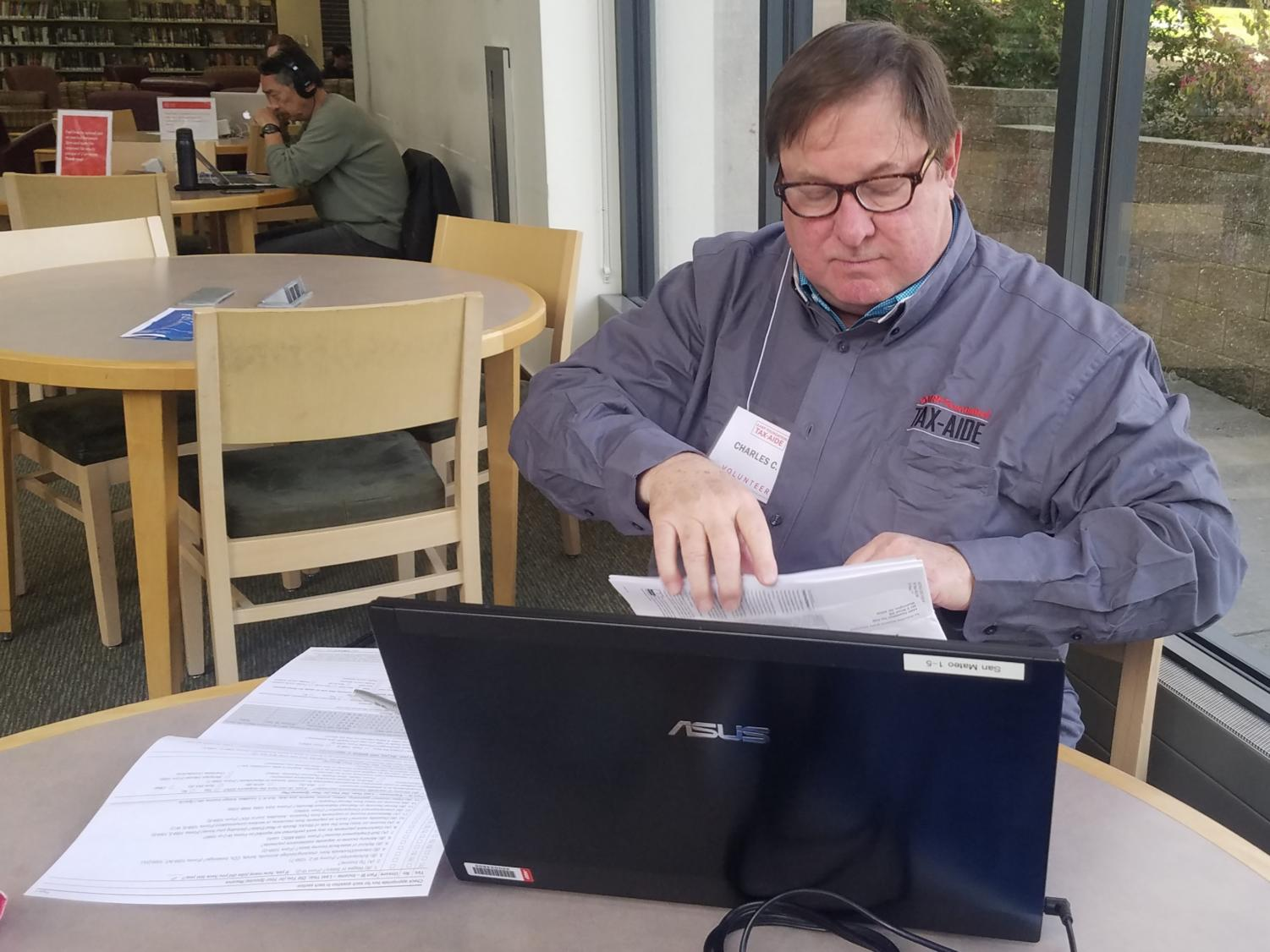 The volunteers sent by AARP help locals ensure their taxes are filed correctly.