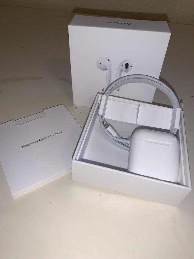 The+box+containing+the+AirPods+also+comes+with+a+charger+and+a+booklet+containing+instructions.+