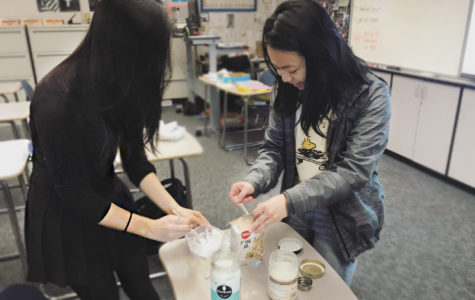 Club President Alyssa Nguyen and club member Serena Low make natural toothpaste in reusable containers