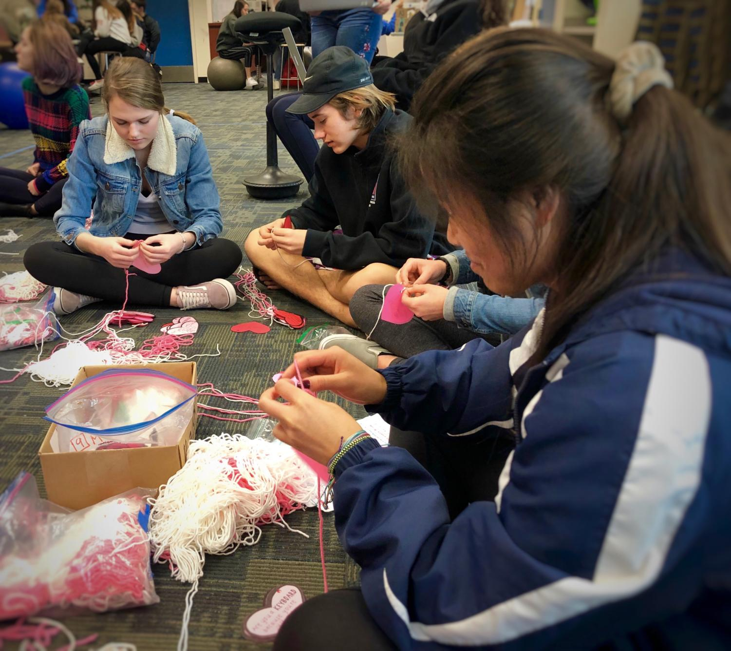 ASB's recognition committee works together to make Carlmont's annual Valentine's Day personalized heart decorations.