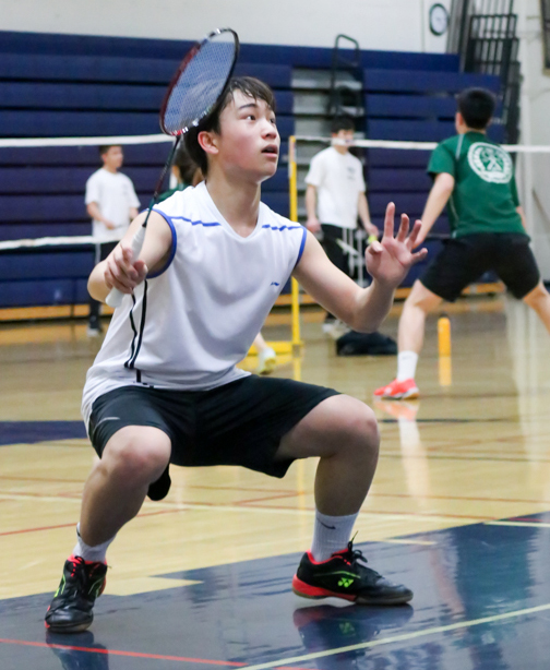 After losing his second game, sophomore Ethan Liu regains his focus for the third game and prepares to clear a smash from his opponents.