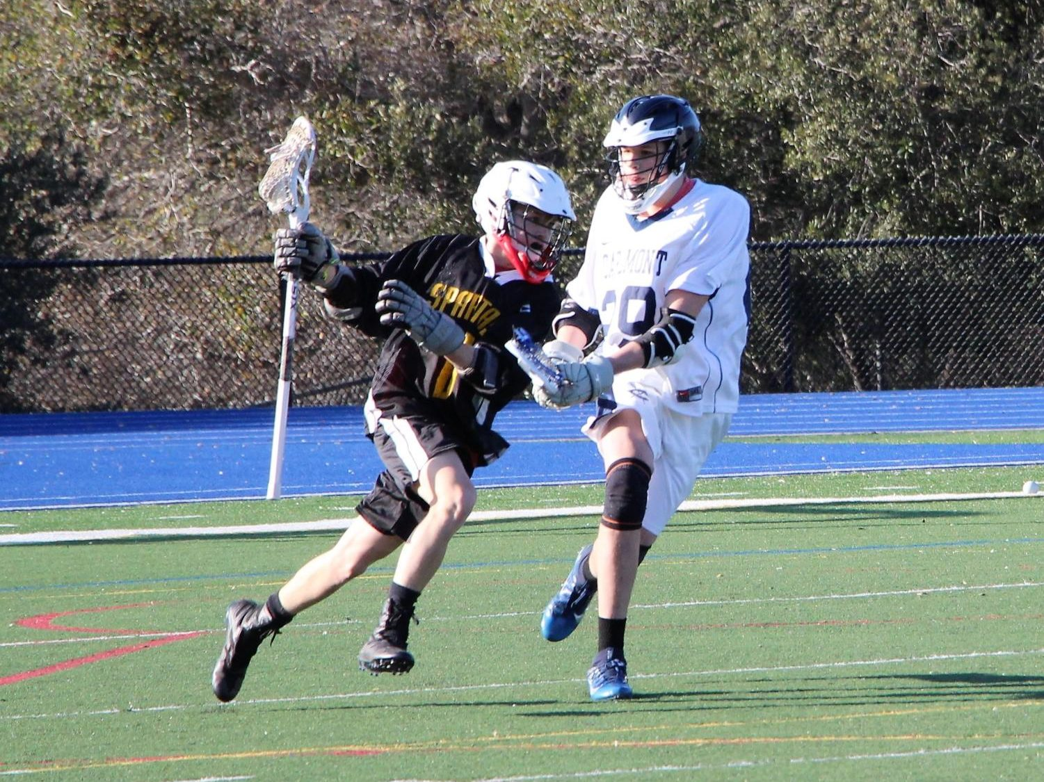Sophomore Reid Rodriguez challenges a Mountain View attacker.