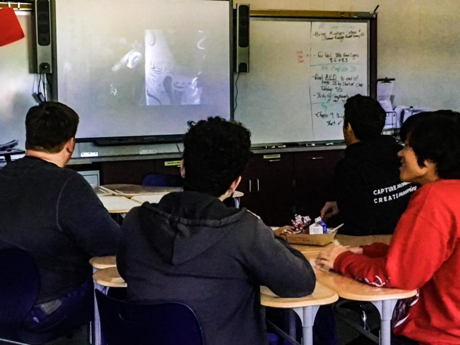 Members of the Classic Films Club watch and discuss