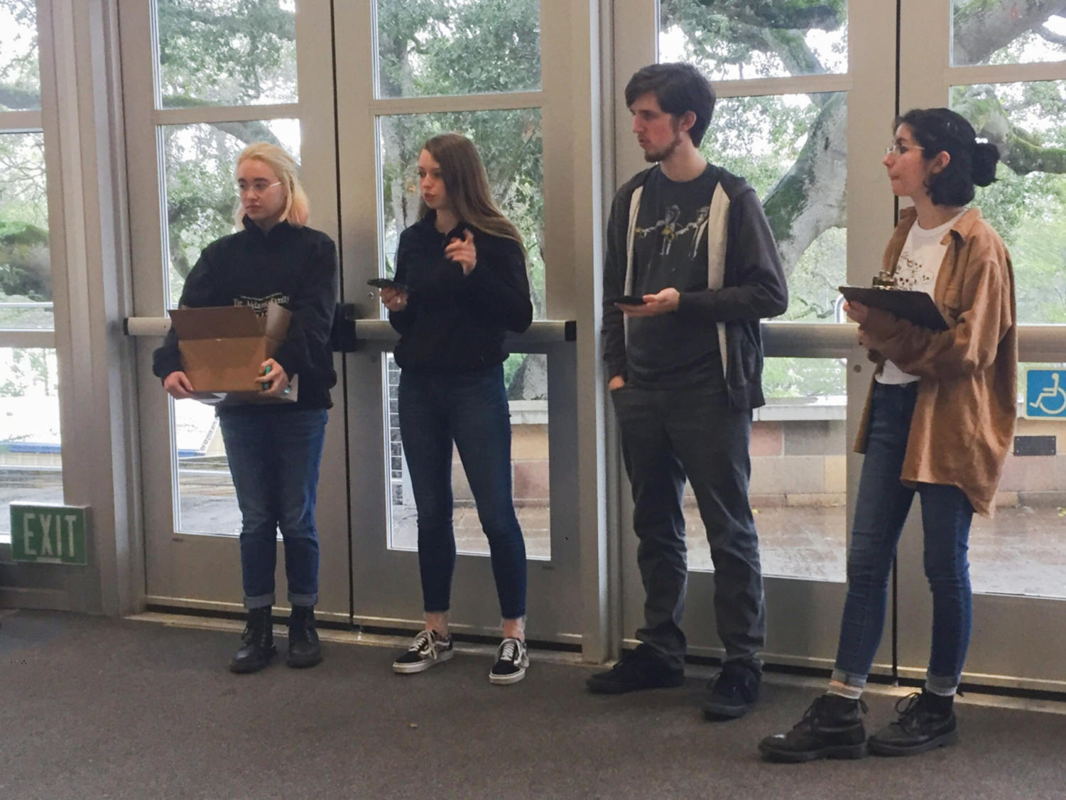 The Carlmont Technical Theatre Association's executive team makes announcements during their club meeting on Tuesday.