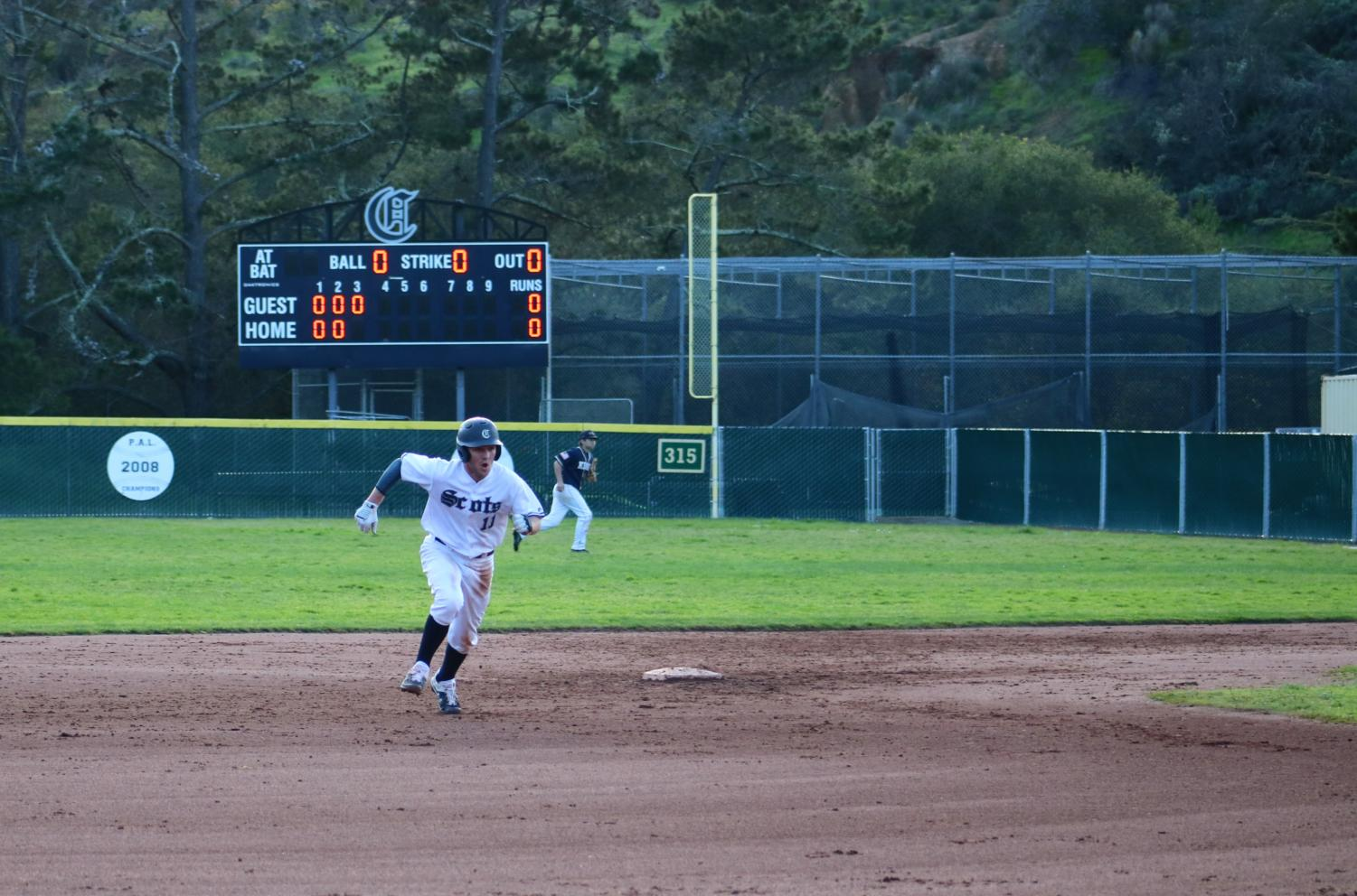 Jake Robinson, a senior and right fielder, runs to third base.