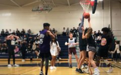 Junior Catherine Dahlberg attempts to shoot a basket for the junior team during one of the many games played in Mini Madness.