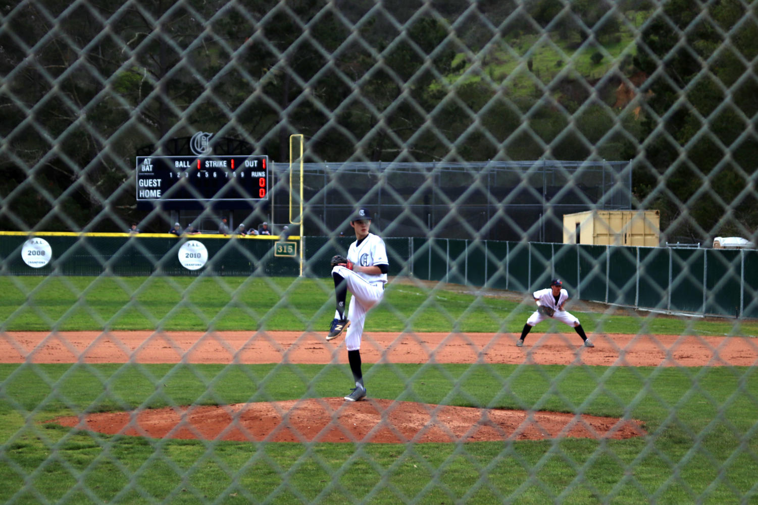 Starting pitcher Tai Takahashi, a sophomore, winds up to throw a pitch to the batter.