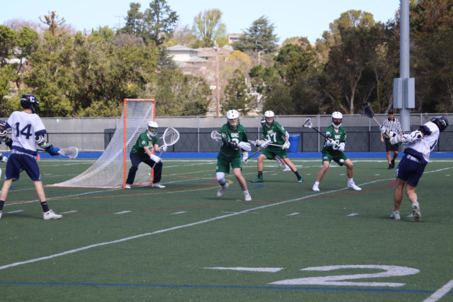 Adrian+Cunningham%2C+a+senior%2C+rips+a+shot+and+scores+against+Sacred+Heart+Cathedral+Prep.