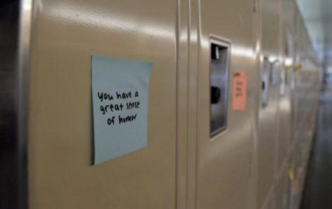 Sticky notes with kind messages are posted on every locker.