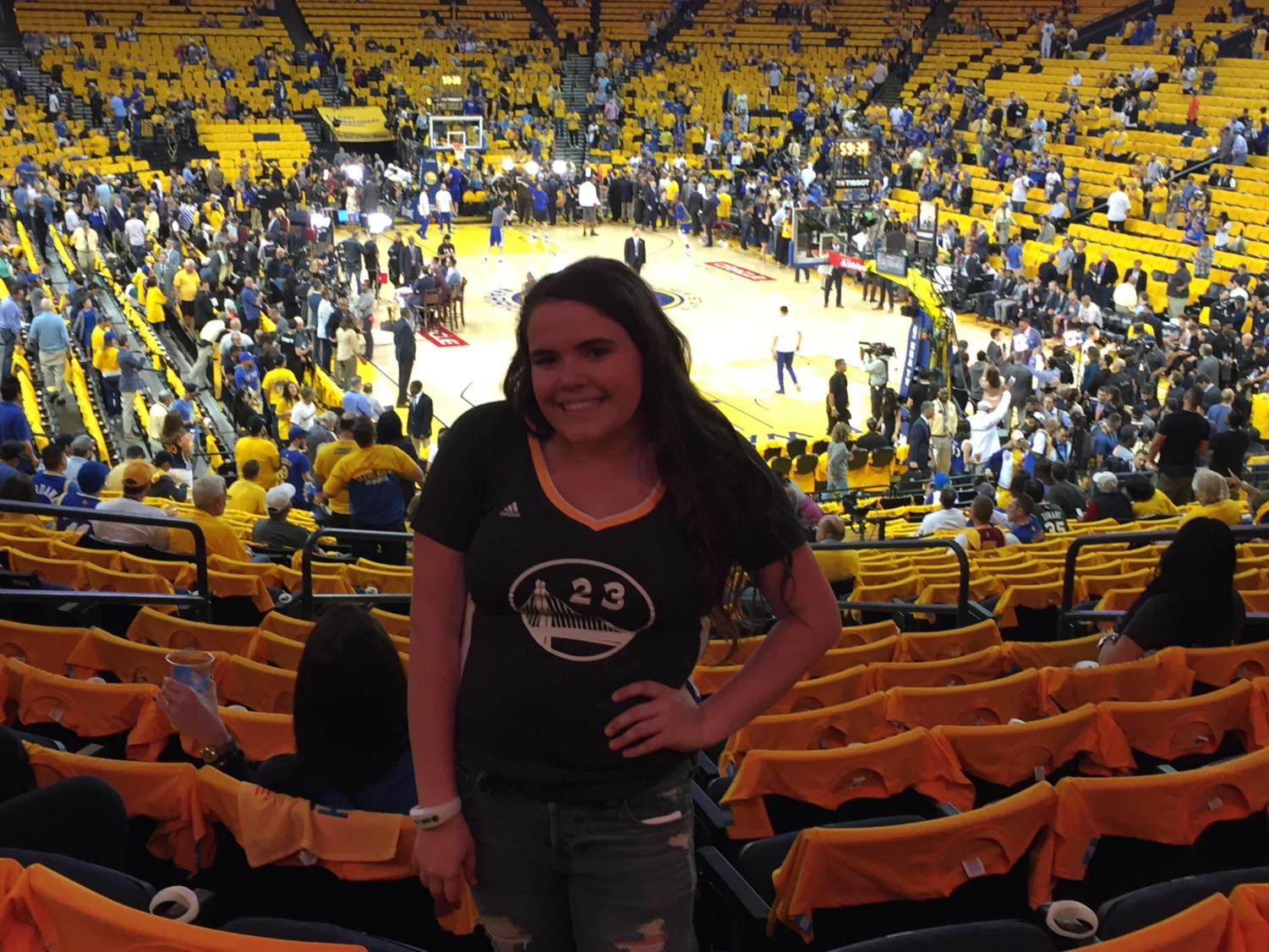 A photo of me (Lizzy Hall) at Oracle Arena, which was filled with fans dressed in blue and yellow during the 2017 NBA Finals.