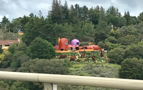 The backyard of the Flintstone House and the added dinosaur constructions. The owner has recently been sued by the city of Hillsborough for these constructions.