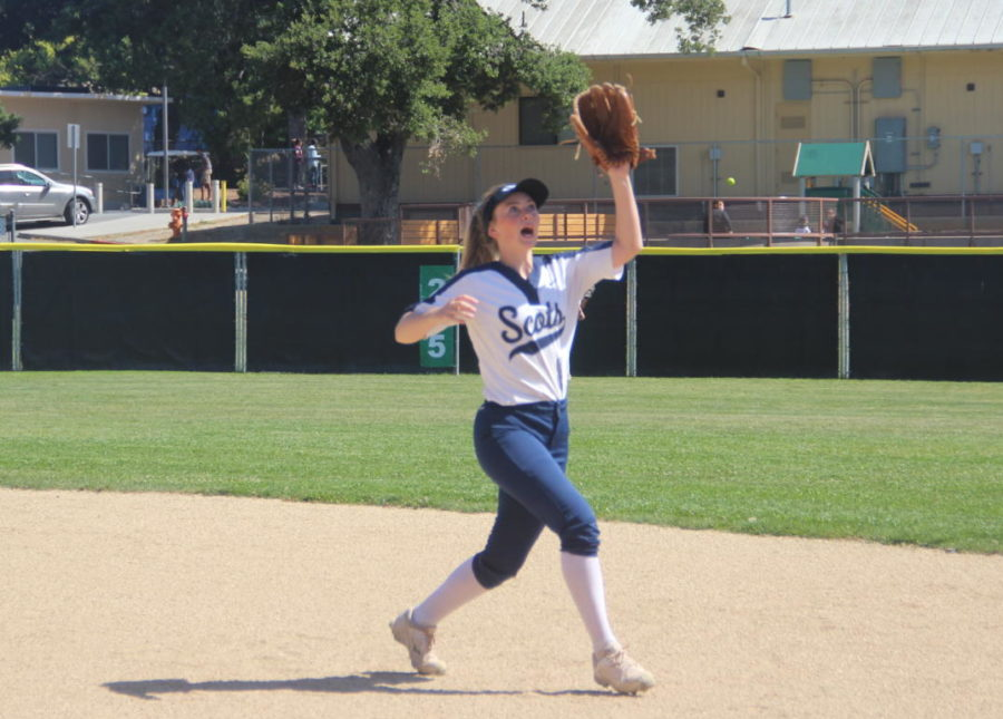 Dana Knoble, a sophomore, races to field the ball on a bounce.