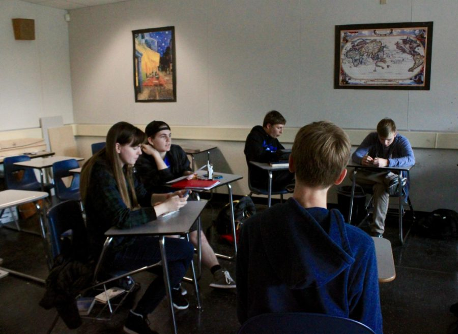 Students in Philosophy Club discuss excerpts from