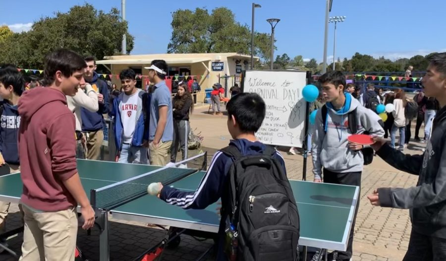Students battle each other in Ping Pong as one of the many activities of the carnival.