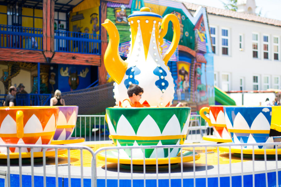 A boy enjoys the teacup ride at Mount Carmel's Wild West Days 2019 festival.