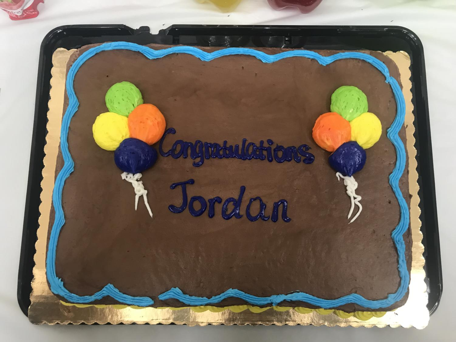 The+library+bought+him+a+cake+that+had+%22Congratulations+Jordan%22+balloons+written+on+it.