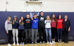 Senior athletes sign with colleges to continue playing sports