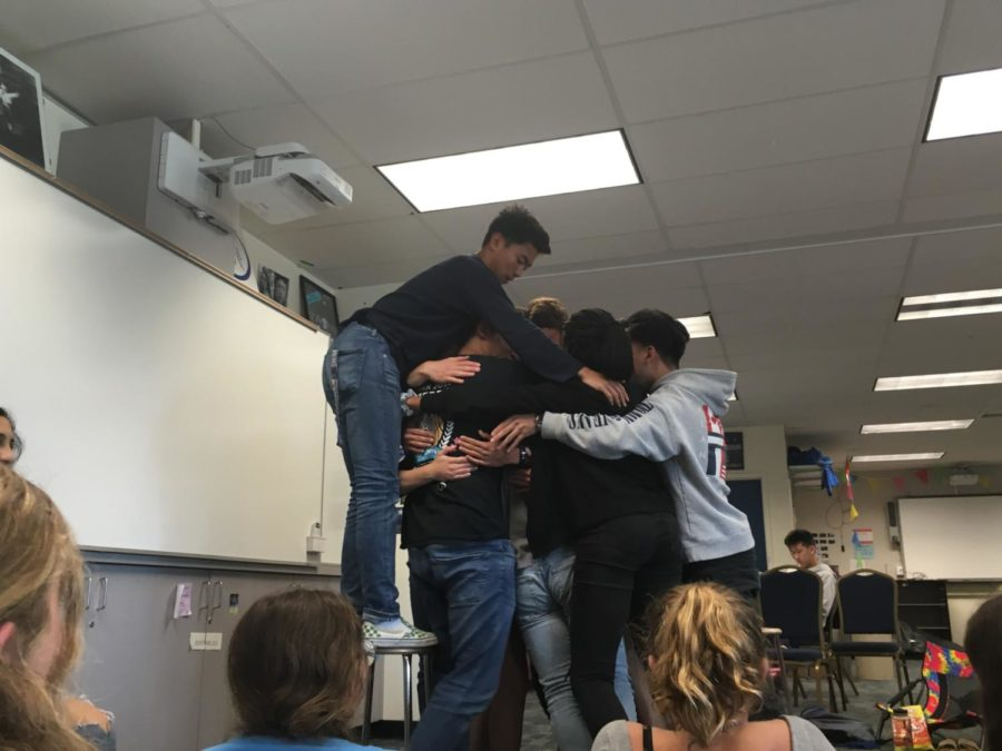 A few ASB members huddle together after an emotional speech.