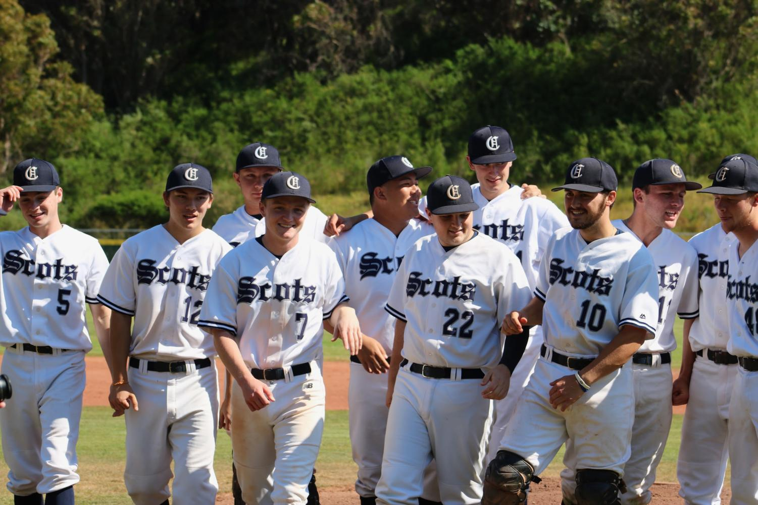The Carlmont varsity baseball seniors enjoy a moment together before their last league home game.