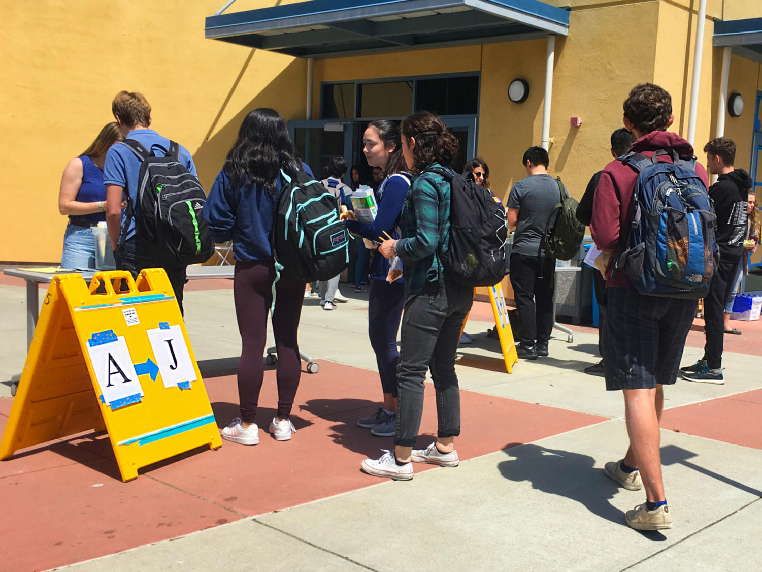 Students receive their paperwork for the Physics C: Mechanics AP test on May 13.