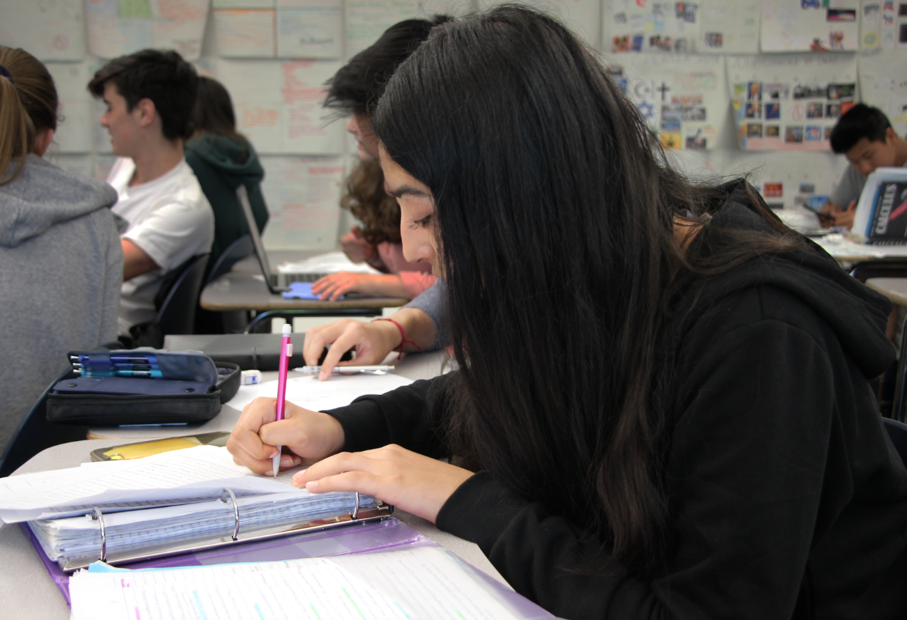 Tara Roshan, a sophomore, works on a project during AP Euro class despite senioritis