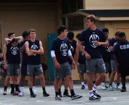 Carlmont Football team warms up for an early workout and practice.